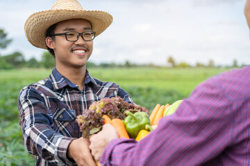 Asian farmers are delivering fresh vegetables to customers.