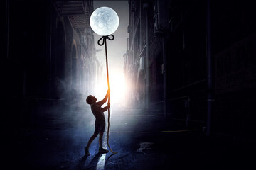 Kid boy catching moon . Mixed media