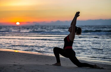 Wall Murals Yoga school Woman doing yoga at the beach at sunset