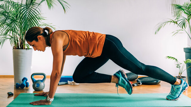 Mountain Climbers, Woman Exercising Indoors, HIIT or high intensity interval training