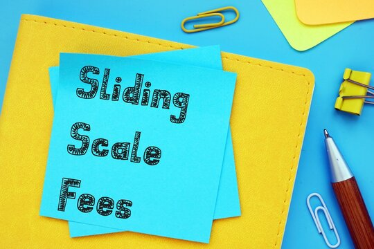 Business concept about Sliding Scale Fees with sign on the sheet.