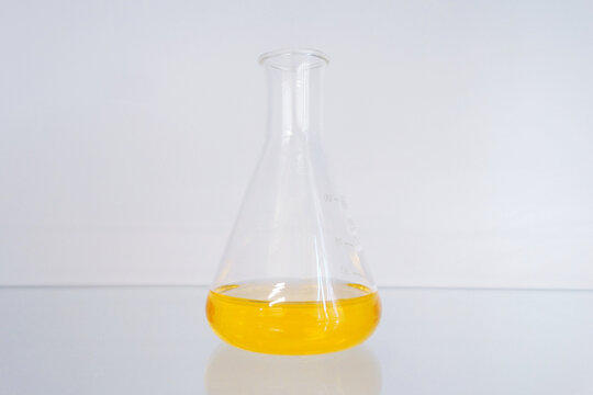 yellow chemical solution in a conical flask