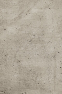 Cream-colored old marble-style concrete wall with cracked and weathered areas.