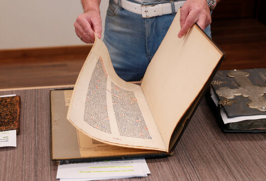 Ukrainian opposition politician Medvedchuk shows a fragment of the Gutenberg Bible during an interview in Kyiv