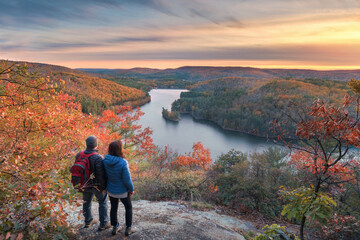 Wall Murals Deep brown hikers at a beautiful overlook in the fall at sunset