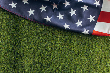 top view of american flag on green grass outside, labor day concept