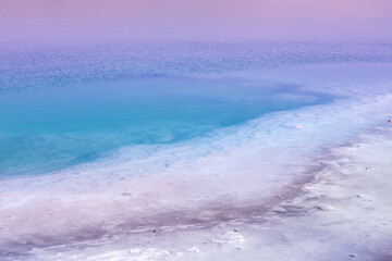 Fototapete - Dead sea in the early morning. Wild nature. Tropical minimalist landscape. Sunrise over the sea. Gradient color. Summertime.