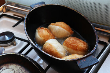 making deep-fried pastry pies in the kitchen