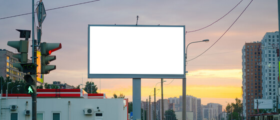 Obraz Advertising billboard advertising large horizontal screen MOCKUP for advertising. Against the background of the sunset, glowing. - fototapety do salonu