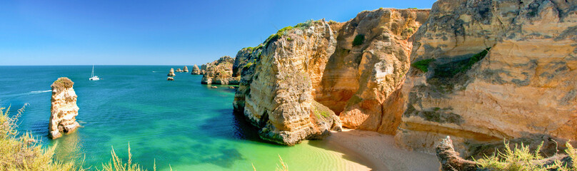 Panoramic view of a beautiful beach with cliffs, Algarve Portugal