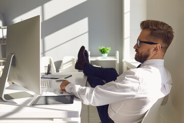 Businessman resting relaxes meditating dreams at the workplace at the table with a computer in...