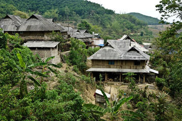 Fototapeta Wood houses with tin roofs in a Jinuo ethnic minority village, Xishuangbanna, Yunnan Province, China obraz
