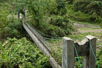 Fototapeta Suspension bridge at the Jinuo ethnic minority village of Ba Ka, Xishuangbanna, Yunnan Province, China obraz