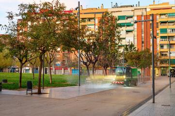 Watering machine, park, apartments, Barcelona