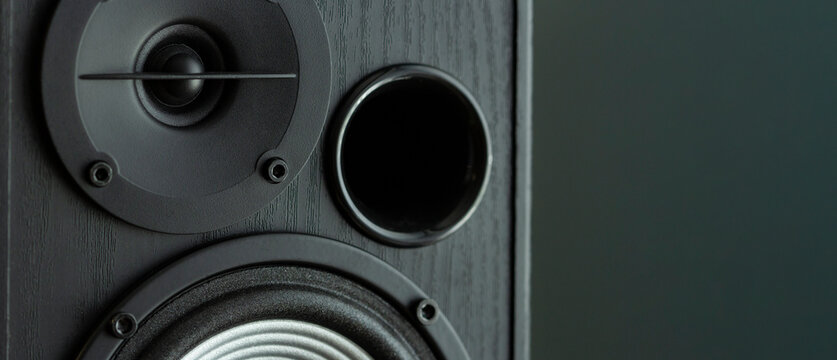 Acoustic sound speakers on black background. Multimedia, audio and sound concept. copy space.