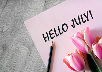 Garden Poster Tulip Hello july text on a pink sheet with a black pencil and a bouquet of tulips