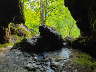 Cave entrance at Pietrele Vorbitoare waterfalls