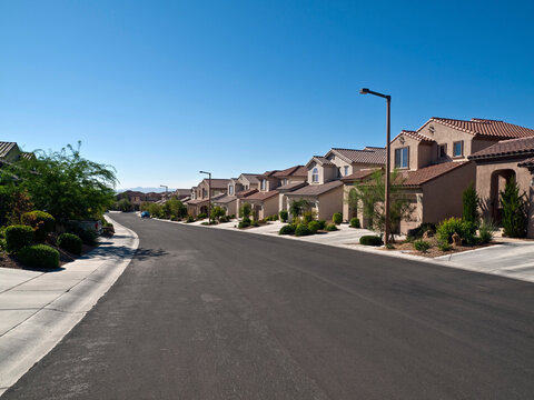 Typical street of suburban desert homes near Las Vegas Nevada.
