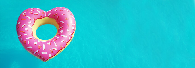 Heart shaped inflatable ring floating in swimming pool on sunny day, above view with space for...