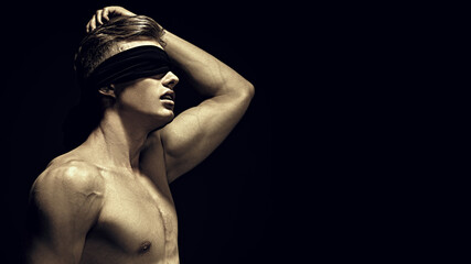 young blindfold bodybuilder