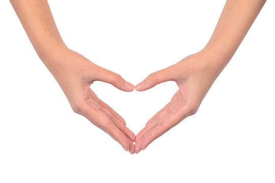 Close up of beautiful female hands in heart shape isolated on white background