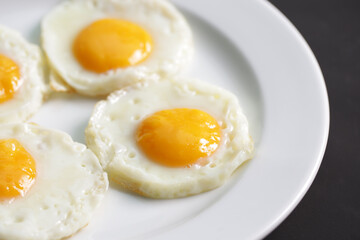 Four fried eggs for healthy breakfast.