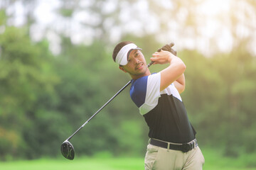 Golfer playing on beautiful golf green course.
