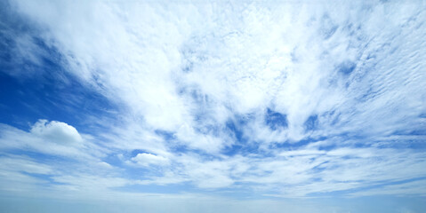 Blue sky background with clouds. Panorama