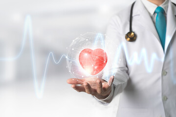 Medicine doctor holding red heart shape in hand with Technology Innovation and medicine concept.