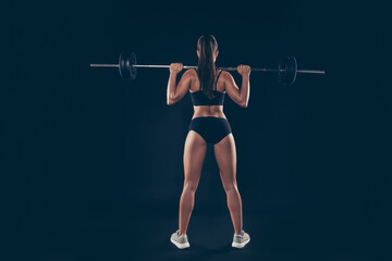 Fotobehang Ezel Full size rear behind photo active short sport suit lady heavy barbell shoulders competition isolated black background