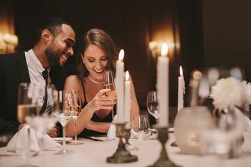 Loving couple at gala night dinner