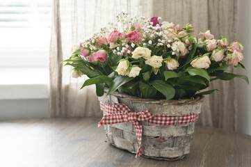 Flowers bouquet in basket