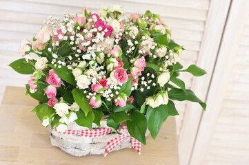 Flowers bouquet in wicker basket