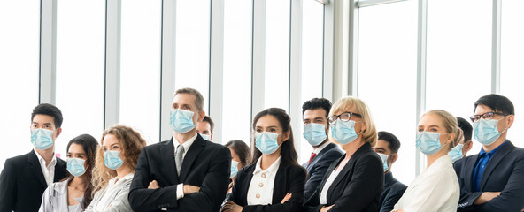 Confident business people with face mask protect from Coronavirus or COVID-19.