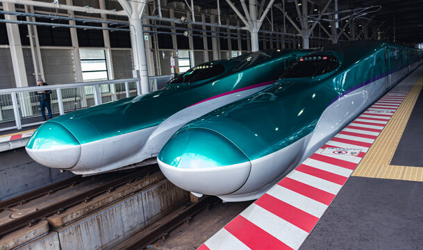 TOKYO, JAPAN - OCTOBER 26, 2017 : Japan high speed bullet train stop at Railway Station platform.