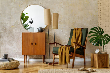 Modern retro composition of living room interior with design armchair, pouf, tea pot on the tray, plant, plaid, carpet, decoration and elegant presonal accessories in wabi sabi concept.