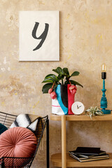 Stylish composition of sitting room interior with mock up photo frame, wooden console, design armchair, plants in hipster pot, decoration, book, table lamp and personal accessories.