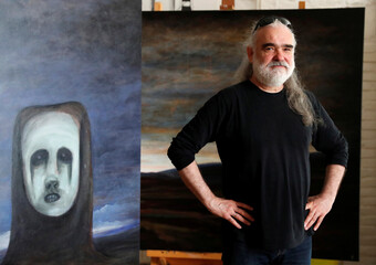Hungarian artist Szurcsik poses for a picture in his studio in Budapest