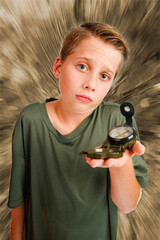 Boy with compass inquiring look mono background
