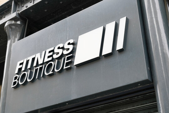 fitness boutique logo sign shop of sporty fit retail chain clothing