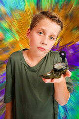 Boy with compass inquiring look colourful