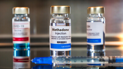 Bottle of methadone injection with a syringe