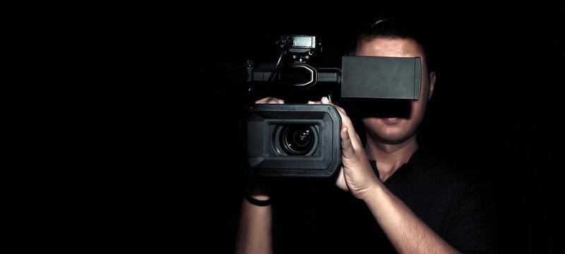 cameraman record movie with digital camera make clip
