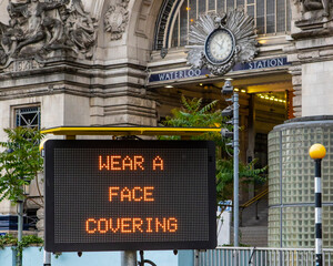 Wear a Face Covering Sign at Waterloo Station in London