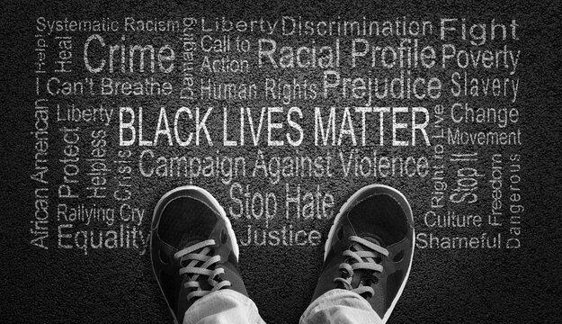 Black Lives Matter Word Cloud on Asphalt Concept of Fighting Racism