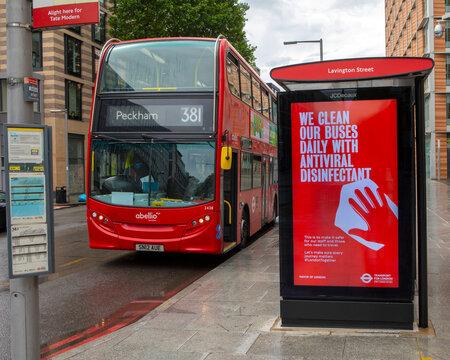 London Bus at a Bus Stop Displaying a Coronavirus Sign