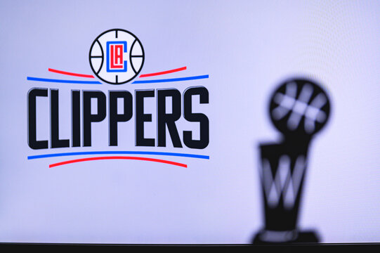 NEW YORK, USA, JUN 18, 2020: Los Angeles Clippers Basketball club on the white screen. Silhouette of NBA trophy in foreground.