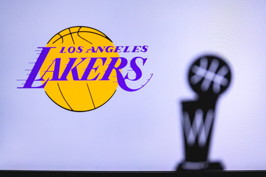 NEW YORK, USA, JUN 18, 2020: Los Angeles Lakers Basketball club on the white screen. Silhouette of NBA trophy in foreground.