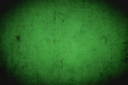 Dirty creepy basement wall in green with dark vignette.