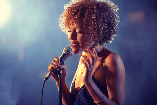 Black female Singer Performing on stage
